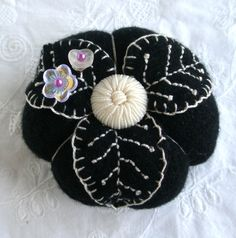 Very elegant simplicity. I like the use of the white/silver thread on the black cashmere.  It brings to mind the elaborate coats worn by the french aristos in the early 18th century. The Oreo Cashmere Pincushion in soft black and by fiberluscious, $20.00