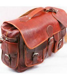 79aa5791af999 Wykonana ręcznie w Marakeshu torba podróżna ze skóry koźlęcej. Skóra jest  wyprawiana i opalana w