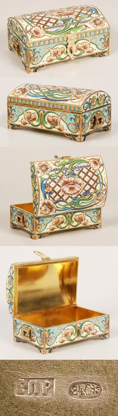 A Russian silver gilt and shaded cloisonne enamel jewel casket, maker's mark EPR, Moscow, circa 1896-1908. Of traditional form on bracket feet, the rectangular box with hinged trunk-shape lid completely worked in multi-color shaded enamel Art Nouveau scroll, trellis and flower-head motifs, hinged handles and hasp.