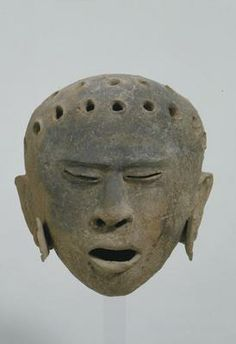 Head. Central America, Mexico, Veracruz: Remojades. Late Classic period (AD 600-900). Terracotta, traces of white stucco and black paint. h. 17.8 x w. 15.5 x d. 16.0 cm. Acquired 1987. Robert and Lisa Sainsbury Collection. UEA 957