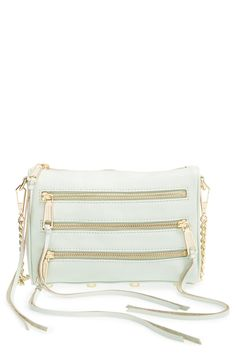 Loving the trio of zip pockets on this modern Rebecca Minkoff crossbody bag.