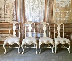 Charming Family of four 18th century Swedish chairs in Rococo period, circa 1760. Lovingly handmade with richly carving in traces of their original worn patina. Each chair being made in slightly diffrent hight. Upholstered with antique raw linen.