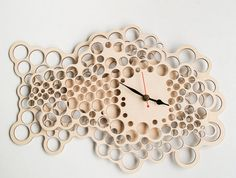 ..product...  The wooden cloud clock is made of two laser cut layers of birch wood. The depth between these layers result in an intricate