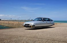 sylvain viau's flying cars hover beside the french seaside