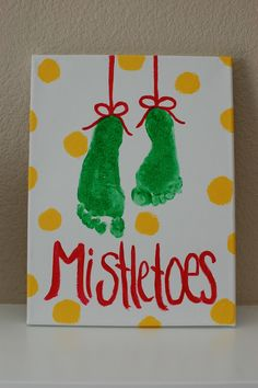 "Use the kids' feet print for the ""Mistletoe""  Once dry paint on Ribbon, lettering and polka dots"