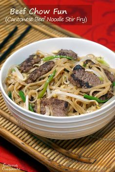 Beef Chow Fun is a Cantonese stir fry recipe using rice noodles, beef, and bean sprouts. You don't need to order takeout to have this easy, flavorful dinner!   www.CuriousCuisiniere.com