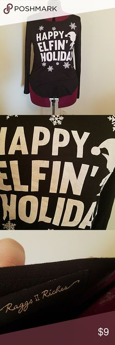 Rags II Riches Long Sleeve Tshirt Never worn and in good condition. This black long sleeve lightweight t-shirt features the saying happy Elfin holiday on the front. There is a slight flaw in the lettering and that is that they are starting to crack without even being washed. But other than that it is in great condition. Size large. 95% rayon and 5% spandex. Raggs II Riches Tops Tees - Long Sleeve