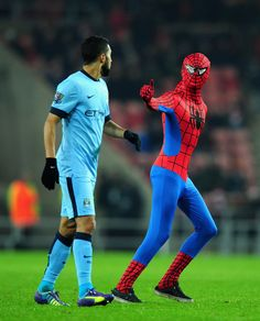 A spectator dressed as Spiderman approaches Manchester City player Gael Clichy during the Barclays Premier League match between Sunderland and Manchester City at Stadium of Light on December 3, 2014 in Sunderland, England.