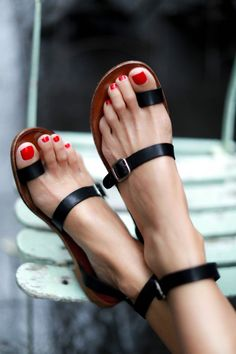 Black leather sandals with ankle straps