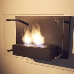 Radia Wall-Mounted Fireplace. This would be great in Tony's man cave!!