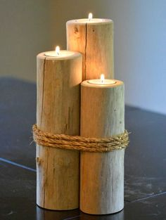 Pilings Candle Holder Idea... http://www.completely-coastal.com/2016/10/nautical-piling-decor-ideas.html Small wodden pilings with rope. Top cut -out to fit tealights.