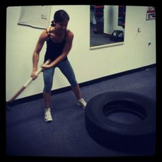 Kickass functional fitness training---sledgehammer and a tractor tire....check!