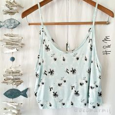"""H&M Aqua Stargazer Lily Top  H&M } Divided Made in Cambodia  Boho style with v back design  Flowly feel + textured fabric  Silky Soft 100% Viscose  Size} M can fit S as well  measures laying flat \\ 19"""" bust (armpit to armpit) 21"""" long (shoulder strap to hem) Brand: H&M { Divided } ⭐️ No Flaws ⭐️ Swarovski Prism Necklace is for sale in my closet listing to come soon⭐️ H&M Tops Tank Tops"""