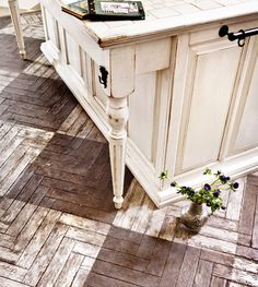 Wonderful distressed timber. Herringbone design stained in two colours to create a block design - very effective