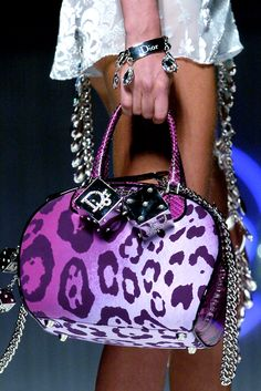 Purple animal print bag, I'd take off the big dice and chains. But super cute