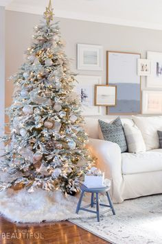 A snowy flocked Christmas tree decorated in silver and rose gold adds a big dose of holiday cheer to this modern farmhouse living room Flocked Christmas Trees Decorated, Rose Gold Christmas Decorations, Frosted Christmas Tree, Beautiful Christmas Trees, Christmas Tree Themes, Noel Christmas, Holiday Decor, Silver Christmas Tree, Christmas Mantles