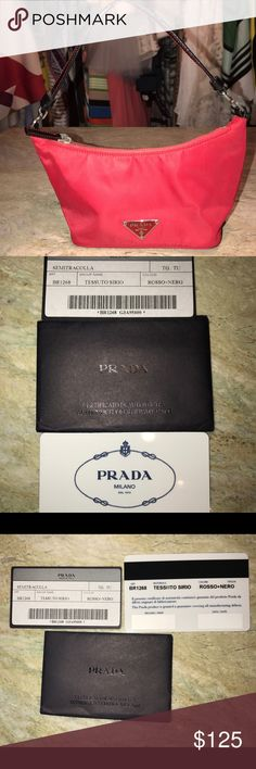 PRADA nylon purse Cherry red (ROSSO+NERO) TESSUTO SIRIO AUTHENTIC clutch purse. This nylon PRADA purse measures 10x4 inches . With black leather strap with red stitching . Comes with authenticate serial/ make and model cards plus a vinyl dust bag. Used only twice. Excellent condition ! Great for going out to dinner or the club. Priced to sell!!!! Prada Bags Clutches & Wristlets