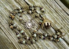 Recovering Catholic/Dysfunctional Buddhist Rosary by DeLucaArt, $54.00