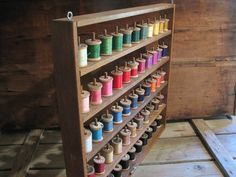 Vintage Sewing Spool Rack Colorful Thread Wooden Sewing Room Crafts Person Storage. $52.00, via Etsy.