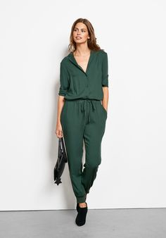 """Boasting ultimate comfort and effortless style, this super flattering jumpsuit is the perfect piece to dress up or down with heels or trainers. • A semi-relaxed fit. Try your usual size. For taller or broader frames, we suggest to try the next size up. • Cuff hems. • Drawstring waist and button to waist closure. • Soft, lightweight material with no stretch. • Inside leg 69cm (size 10) • Model is 5'9"""" and wears size 10."""