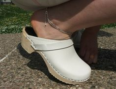 Sexy pose in white clogs. Source: Clogs Love