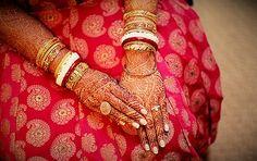 Shakha-Paula: a pair of shell (shakha) and red coral (paula) bangles worn as marriage symbols by the Bengali women ~