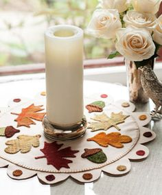 Falling Leaves, featured in Love of Quilting September/October 2013, is a felted wool appliqué table topper featuring autumn leaves and acorns. Project by Christine Baker.