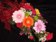 Arm bouquet of gerbera daisies and other flowers.