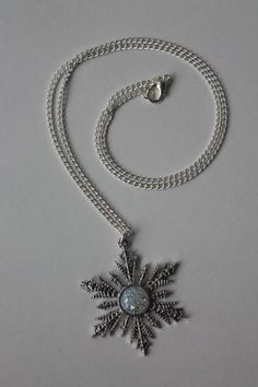 This is a replica of the snowflake necklace given to Anna by Elsa before her marriage to Kristof on ABCs Once Upon A Time. Elsa later finds this