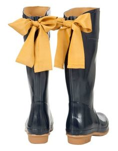 Rain boots Yellow Ribbon Wellies - - I feel like you could do this to any  pair of rainboots. and it would be cute to switch out the color of the  ribbons ... 9a800ed0908