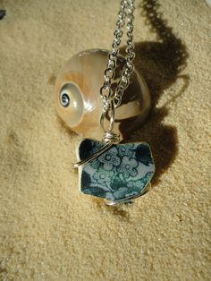 Floral beach pottery shard necklace by atreasurefromthesea on Etsy, $18.99
