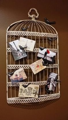 Paris Je T'aime bedroom theme created by Kelli Bill. Vintage postcards and pictures from Paris hanging on metal birdcage wall decor.