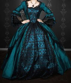 Jael's ball gown: Around the back corner of the house, the wash on the line flapped into view. Faded long johns, dungarees, and a voluminous blue gown wafted in the breeze. He stopped short. The dress was shiny, sateen or something, with black lace up the front. One side of the skirt hung in charred shreds, and the whole thing was about as rumpled and dirty as you'd expect after having been dragged through a lake. (From Storming by K.M. Weiland.)