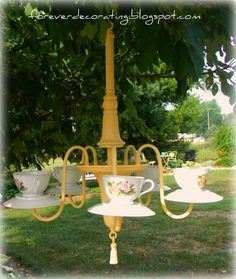 Outdoor CANDLE-lier from an old chandelier! DIY tutorial - add tealights for soft evening lighting.     Or use as a birdfeeder?     http://foreverdecorating.blogspot.com/2011/08/old-chandelier-turns-teacup-candelier.html
