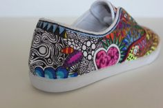 Plain white plimsoles and fabric pens and of course lots of talent!