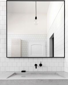 A serious minimalist aesthetic bathroom for a Scandi/Aussie family. Perfectly small square tiles and a concrete basin in the Albert Park house by @clarecousins architecture. : @lgrosmann