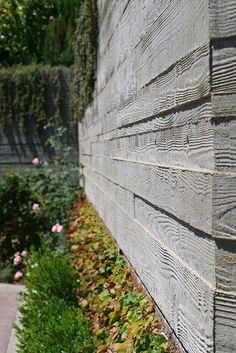 Board formed concrete wall for retaining wall Board Formed Concrete, Concrete Retaining Walls, Concrete Forms, Exposed Concrete, Concrete Wood, Concrete Garden, Concrete Design, Concrete Board Siding, Concrete Fence Wall