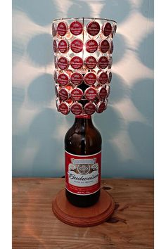 Beer cap lamp - Might need to make one of these to go along with our beer cap table for the back patio!