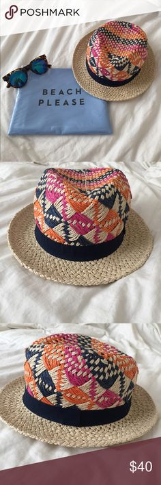 Anthropologie Straw Hat Cute and fun patterned straw hat from Anthropologie! Perfect for all your summer adventures. Perfect condition only worn for an hour. Tan brim, navy band at base, orange, pink, and navy patterned top. Anthropologie Accessories Hats