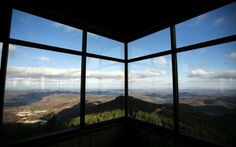 Wide-ranging views, towers, cabins, and more attract visitors to New England's peaks no matter the season.