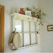 Have an old window? Add a shelf and some hooks and hang it on your wall.