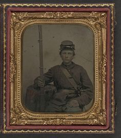 [Unidentified young soldier in Union uniform with musket and bayonet in scabbard] (LOC)