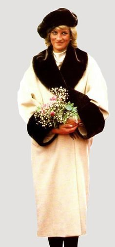 On November 6, 1987, Diana visited Hamburg, Germany wearing a coat designed by Arabella Pollen with a fake fur trim on the collar and cuffs and a fake fur beret-style hat.