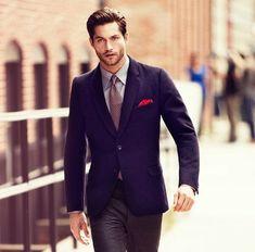 Gray pants, navy jacket, red pocket scarf