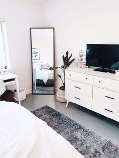 Clean aesthetic bedroom | @blairewilson fresh, bedroom, white, minimal, plant, room makeover, full length mirror, area rug, tv, aesthetic, home, inspo, inspiration, goals, style, cozy, loft style, blaire wilson room, blaire wilson bedroom, all white, boho, modern, blogger, organized, tidy, urban outfitters, living spaces, home good, amazon,  #bedroom #bedroomideas #bedroomdecor