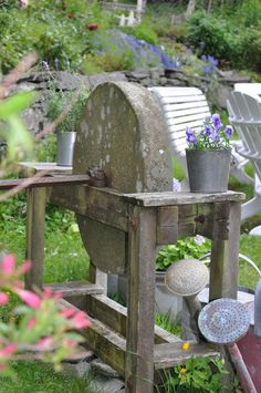 An old grindstone in the country garden