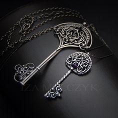 Matthiola key shaped pendant by Iza Malczyk, silver, amethyst, wire wrapping, wire sculpting. http://www.izamalczyk.com/en/gallery-631-4523.html