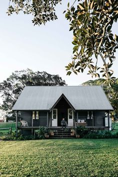 Take out the walls and have it as a picnic house/ folly in the paddock, away from the main house. Australian country cottage, dark grey with huge fig tree. Melbourne interior photographer, Marnie Hawson for Country Style and Fork & Farrow, Nashua NSW Farm Cottage, Cottage Homes, Cottage Style, Country Cottage Decorating, Australian Country Houses, Australian Homes, Australian Farm, Melbourne, Exterior Paint Colors For House