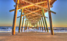 North Carolina's Emerald Isle, located in the southern Outer Banks, is perhaps the most beautiful stretch of sand in the Carolinas. Calm waters make it a perfect choice for safe swimming, and if you get bored with lazing in the sand, hop on a boat for some dolphin watching. http://www.usatoday.com/story/travel/destinations/2013/07/07/10-uncrowded-atlantic-beaches-for-summer/2493875/