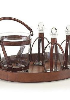 Add rustic character and style to your buffet while not in use with the Leather Decanters & Ice Bucket Set.